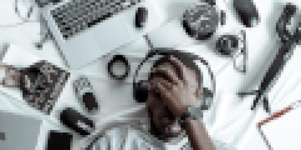 Man w/ Gadgets Facepalming pixelized